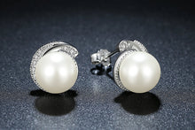 Load image into Gallery viewer, Silver pearl earrings with cubic zirconia on black background
