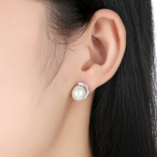 Load image into Gallery viewer, Silver pearl earrings with cubic zirconia on woman