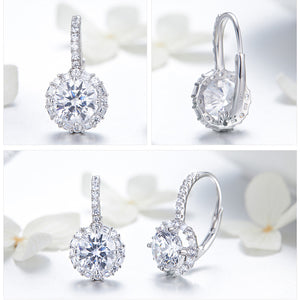 Drop earrings with cubic zircons from different angles