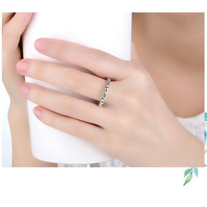 Silver Love Heart Ring on woman holding a cup