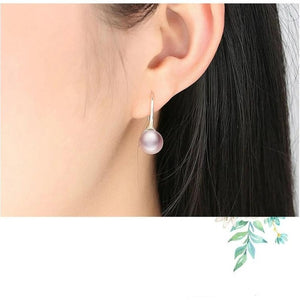 Silver Pearl drop earrings in rose colour on woman