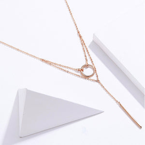 Double layer geometric necklace with a small circle and delicate column in rose gold