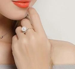 Silver Pearl Ring on woman