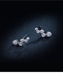Trail bubble silver earrings with clear cubic zirconia in black background