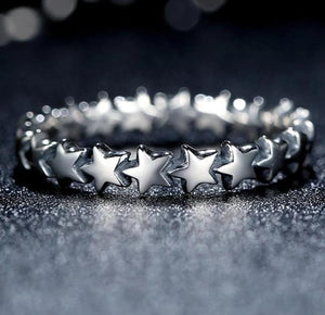 Silver Star Stackable Ring in black background