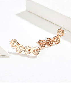 Paw trail earrings in rose gold