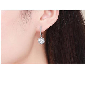 Drop earrings with cubic zircons on woman