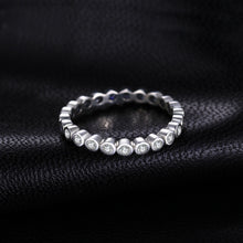 Load image into Gallery viewer, Eternity band Stackable Ring with Cubic Zirconia on black background