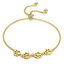Load image into Gallery viewer, Adjustable Paw bracelet in gold finish