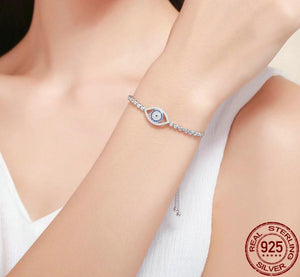 Silver blue eye bracelet with cubic zirconia on woman