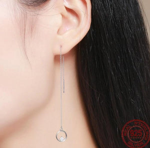 Long tassel circle drop earrings with cubic zirconia on woman