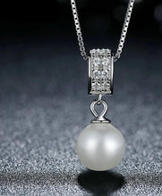 Load image into Gallery viewer, Drop pearl necklace with Zirconia on black background