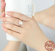 Load image into Gallery viewer, Silver Pearl Ring on woman holding a cup