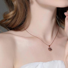 Load image into Gallery viewer, Flower necklace with cubic zirconia in rose gold with colourful crystals on woman