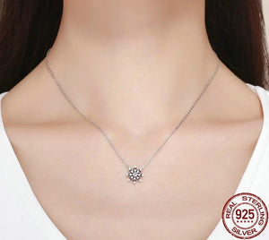 Snowflake silver necklace with cubic zirconia on woman