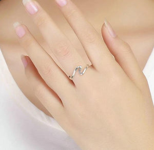 Silver Geometric Wave Ring with Cubic Zirconia on woman