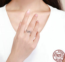 Load image into Gallery viewer, Woman wearing adjustable paw sterling silver ring on middle finger