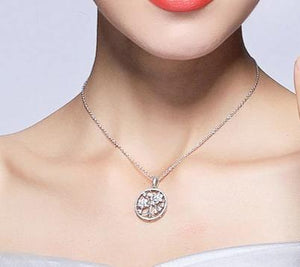 Silver Tree of Life Necklace with cubic zirconia on woman