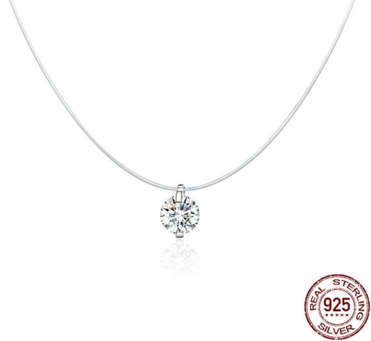 Silver necklace with clear cubic zirconia on woman