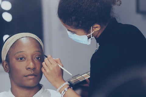 Temi Nuga having her make-up done at the Blue Elvin photoshoot.