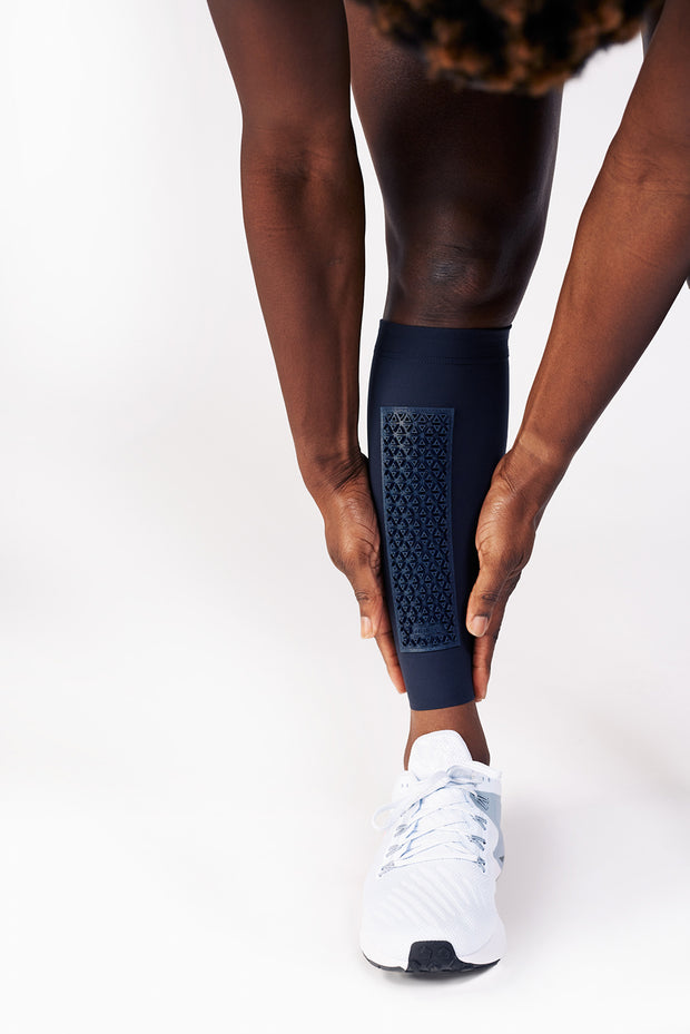 Phyllis Agbo adjusting her Blue Elvin shin sleeves, with shin protection panels.