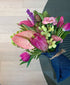 Hand tied tropical flower arrangement, delivered on-demand.