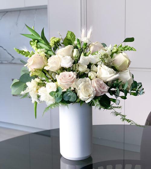 Classic white and green flower arrangement in a modern white vase. Send in Toronto or the GTA (Markham, Vaughan, Mississauga, Scarborough, Burlington)