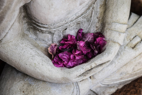 Image of statue with flowers