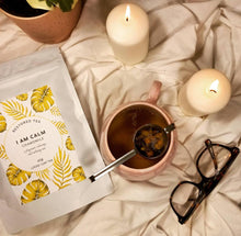 Load image into Gallery viewer, Organic Chamomile tea on bed sheet surrounded by candles