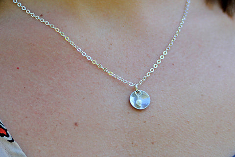 Sterling Silver disk with small freshwater pearl