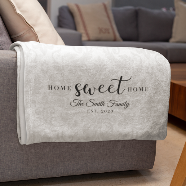 blanket over couch with personalized text saying Home Sweet Home, The Smith Family
