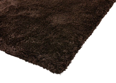 Image of Luxe vloerkleed Easy Living Plush Shaggy Dark Chocolate hoek detail Vloerkledentrends hoogpolig bruin tapijt