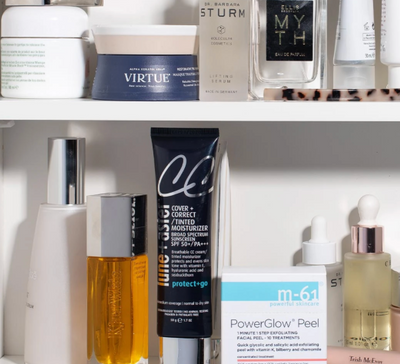 A bathroom cabinet filled with makeup and skincare products