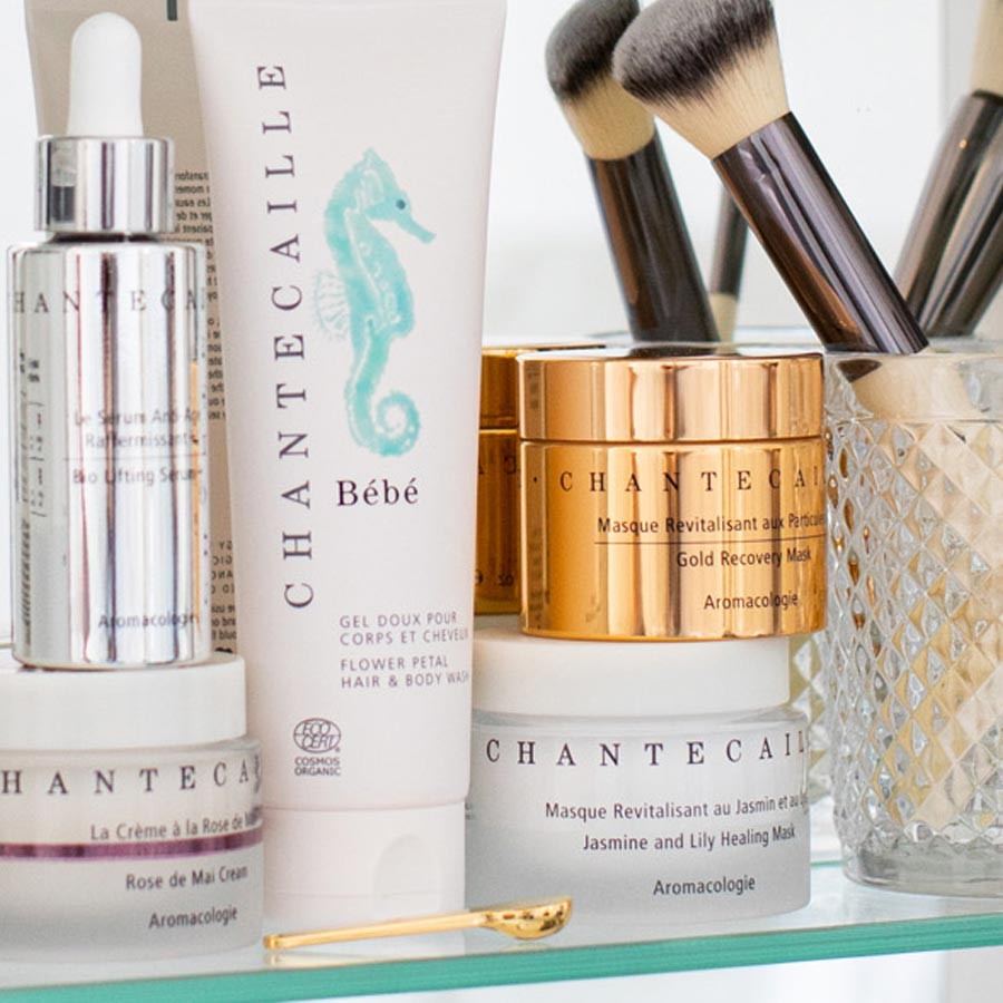 A group of Chantecaille products on a shelf