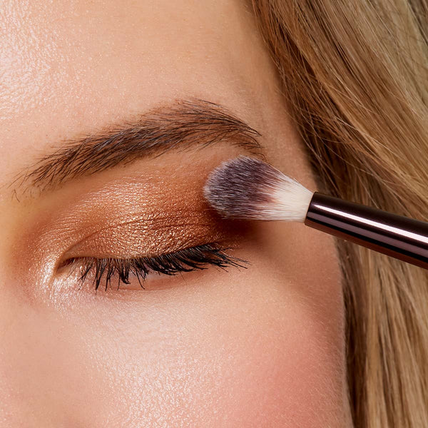 A woman applying eyeshadow