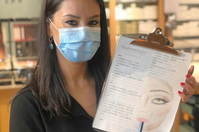 A Bluemercury Beauty Expert with a face chart