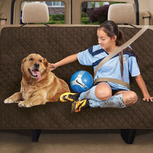 Load image into Gallery viewer, Teenager and dog sitting on protector in backseat of a car