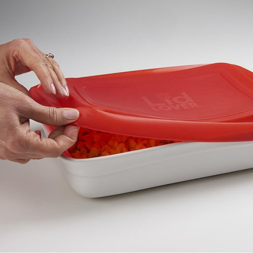 Woman taking Lidlover Rectangle Silicone Lid off container