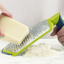 Load image into Gallery viewer, Cheese being grated on Joseph Joseph Twist Grater