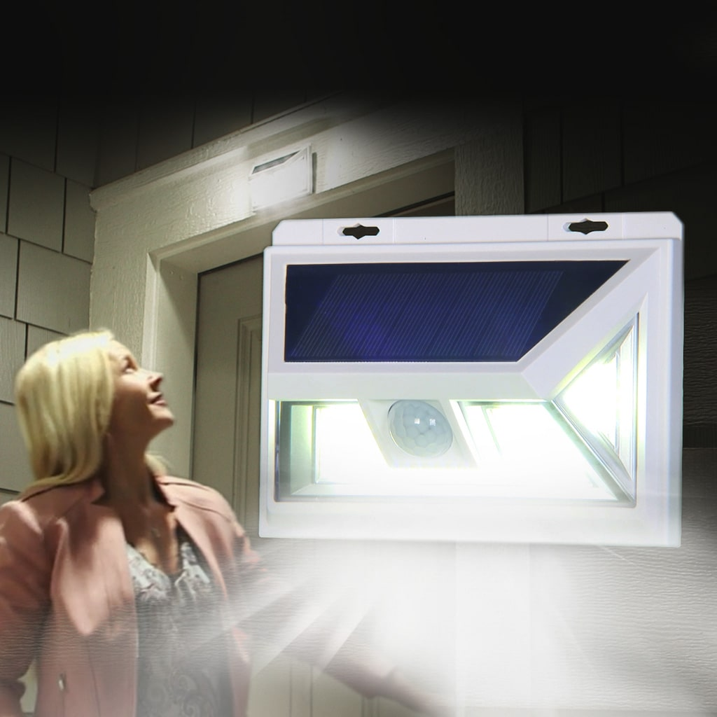 Woman looking up at Atomic Beam SunBlast attached to the top of doorway and light is on