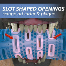 "Load image into Gallery viewer, Closeup of a dog's mouth chewing Chewbrush, includes the text ""Slot shaped openings scrape off tartar & plaque"""