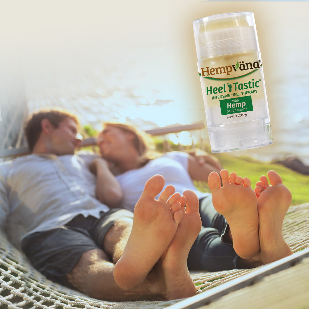 Man and Woman laying next to each other barefoot. Hempvana Heel Tastic stick