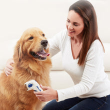 Load image into Gallery viewer, Woman using Flea Doctor on dog