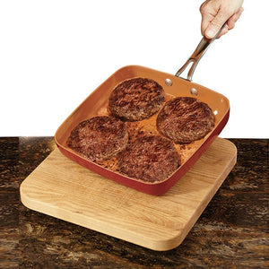 Red Coppr Square Pan with hamburgers cooking in it