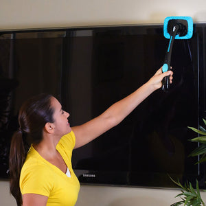 Woman using Hurricane Windshield Wizard on a television