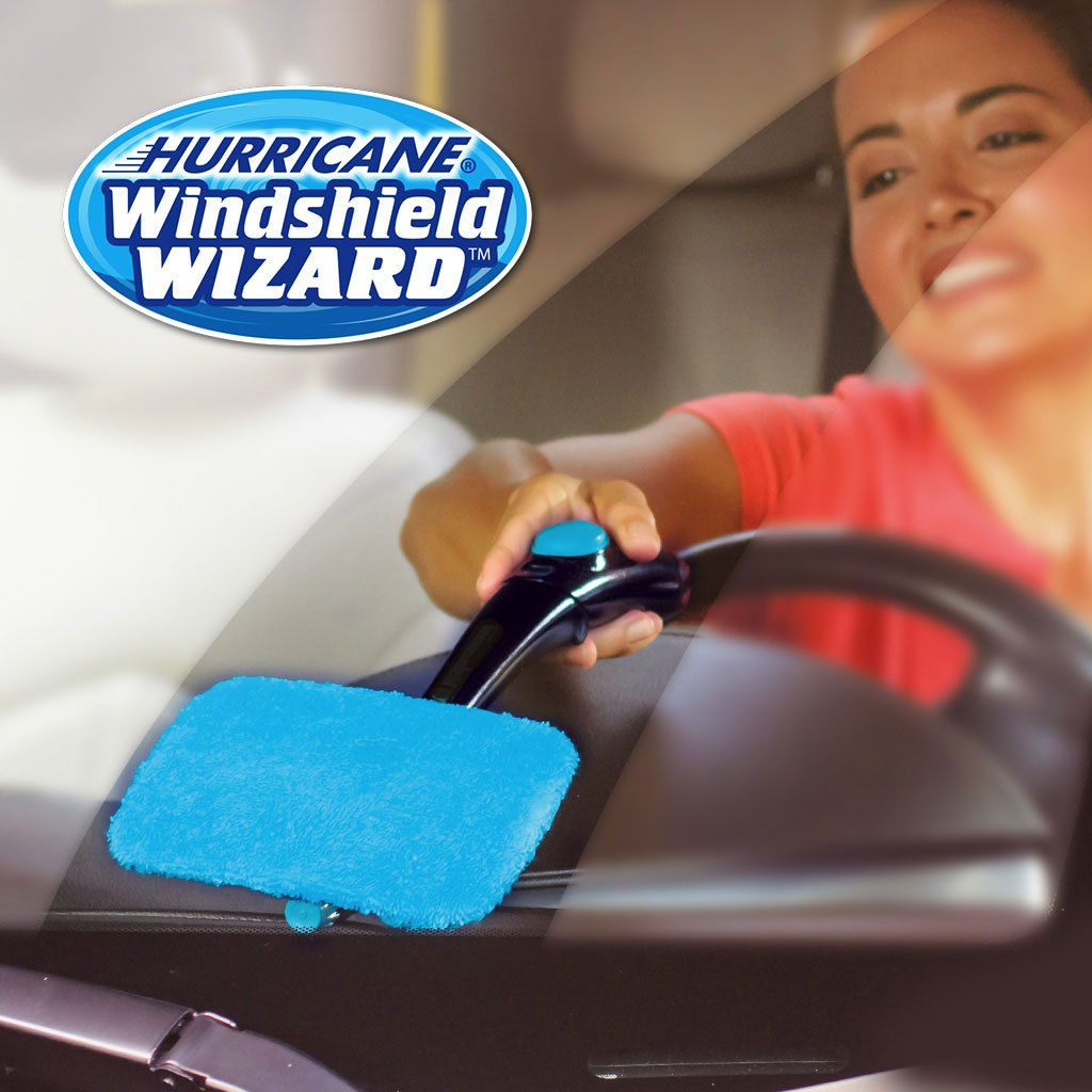 Woman using Hurricane Windshield Wizard on car windshield. Headline says Hurricane Windshield Wizard