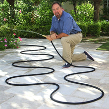 Load image into Gallery viewer, Pocket Hose Brass Bullet Richard Karn using brass bullet hose in a garden