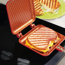 Load image into Gallery viewer, Red Copper Flipwich in use on stove with grilled cheese in it
