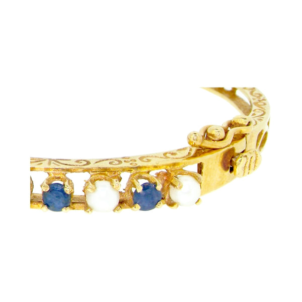 A 14 carat gold pearl & sapphire bangle-NOW ON OFFER
