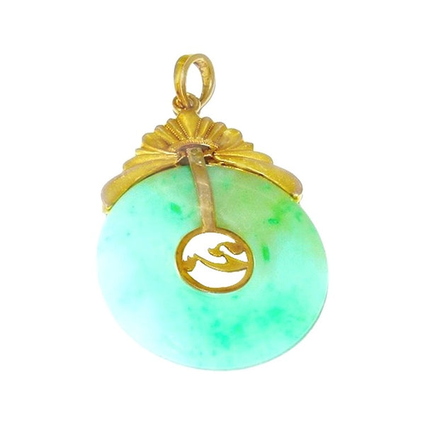 A 14ct gold jade pendant
